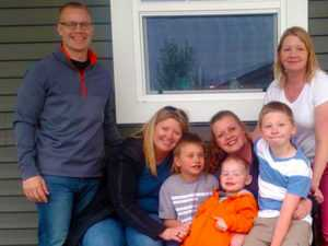 Youth Crisis Services Volunteer of the Month Kerrie Klein (center) pictured with her siblings and nephews.